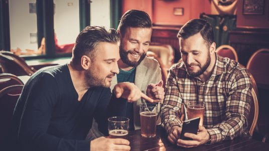 Men drinking in the bar